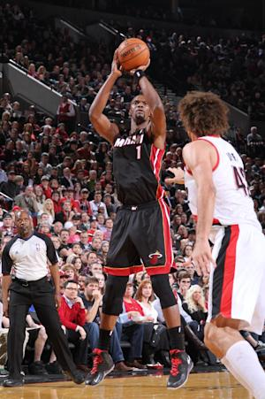 Bosh carries Heat, minus James, past Blazers