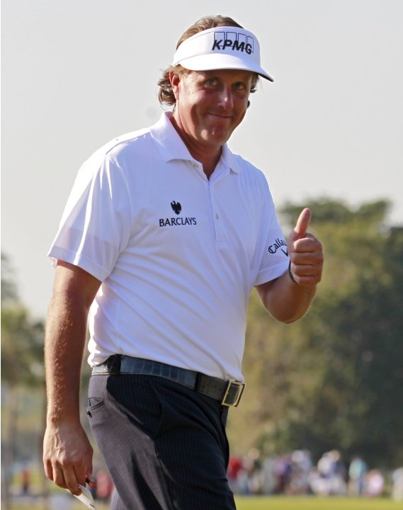 Phil Mickelson of the U.S. reacts to applause after his birdie on the ninth hole during second round play in the 2013 WGC-Cadillac Championship PGA golf tournament in Doral