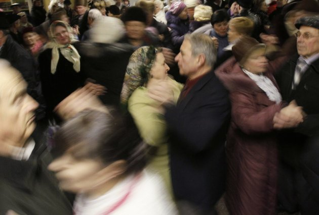 Pensioners dance in an underpass in central Kiev