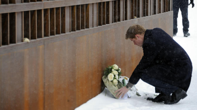 Britain's Prince Harry places a wreath during his visit of the Bernauer Strasse Wall Memorial in Berlin, Sunday, Dec. 19, 2010. The Prince lay a wreath for those who lost their lives on Berlin's East-West border. The Bernauer Strasse Wall Memorial consists of a restored section of Berlin's former East-West border, including the Wall and the area behind it known as the 'death strip'. (AP Photo/Kai-Uwe Knoth)