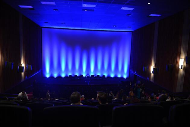 Guests take their seats at the Century Aurora cinema, formerly the Century 16, for a reopening and remembrance ceremony Thursday, Jan. 17, 2013 in Aurora, Colo. The cinema is where 12 people were kill