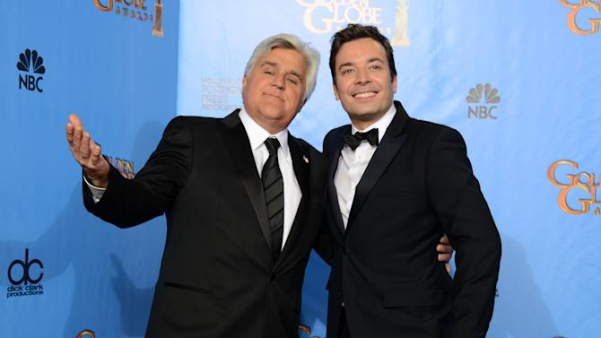 """FILE - This Jan. 13, 2013 file photo shows Jay Leno, host of """"The Tonight Show with Jay Leno,"""" left, and Jimmy Fallon, host of """"Late Night with Jimmy Fallon"""" backstage at the 70th Annual Golden Globe Awards in Beverly Hills, Calif. Leno and Jimmy Fallon poked fun at the late-night rumors swirling around them in a music video that aired between their back-to-back NBC shows on Monday, April 1. In a spoof of the romantic ballad """"Tonight"""" from """"West Side Story,"""" Leno, who was backstage at the """"Tonight"""" show on the West Coast, and Fallon, in his """"Late Night"""" office in Manhattan, serenaded each other by cellphone. (Photo by Jordan Strauss/Invision/AP, file)"""