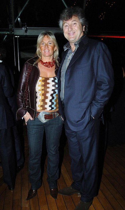 In this photo taken on March 30, 2005 Vittorio Missoni, right, and his wife Maurizia Castiglioni smile in Milan, Italy. The search resumed Saturday, Jan. 5, 2013 for a small plane that has disappeared
