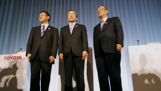 "Toyota Motor Corp. President Akio Toyoda, left, Vice Chairman Takeshi Uchiyamada, center, and Chairman Fujio Cho pose for photos after a press briefing at the company's showroom in Tokyo Wednesday, March 6, 2013. Toyota has tapped a former executive at U.S. rival General Motors to be on its board, the first time in the Japanese automaker's 76-year history it is appointing board members from outside the company. Former President Cho will become honorary chairman and leave the board, while Uchiyamada, a board member and engineer known as ""the father of the Prius,"" Toyota's prized hybrid model, will become chairman. (AP Photo/Junji Kurokawa)"