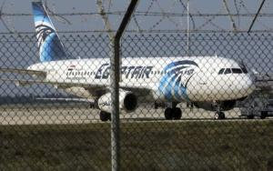 A hijacked Egypt Air A320 airbus stands on the runway …