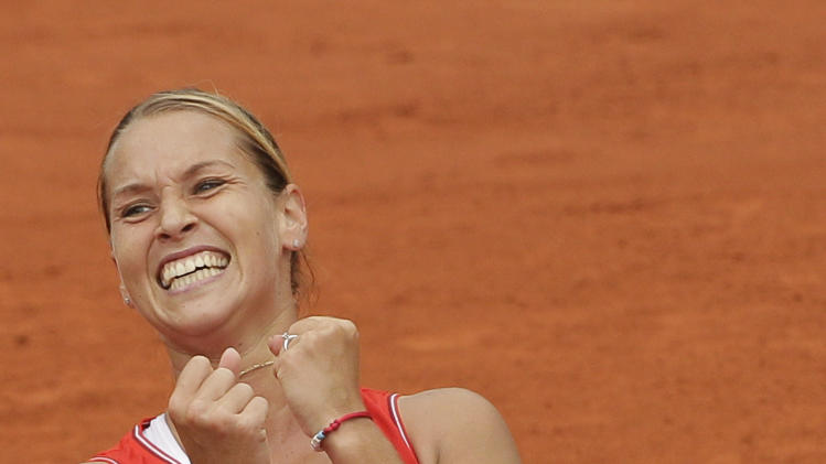 Slovakia's Dominika Cibulkova celebrates her win over Belarus' Victoria Azarenka during their fourth round match in the French Open tennis tournament at the Roland Garros stadium in Paris, Sunday, June 3, 2012. Cibulkova won 6-2, 7-6.  (AP Photo/Michel Spingler)