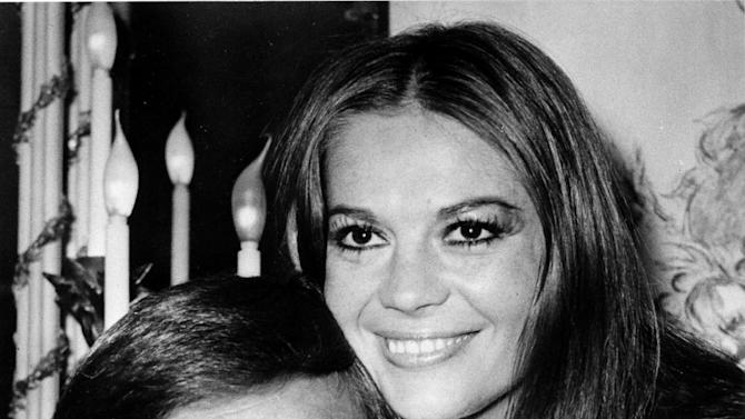 """FILE - In this April 23, 1972 file photo, actor Robert Wagner and his former wife, actress Natalie Wood, pose at the Dorchester Hotel in London, England.  Authorities amended Wood's death certificate on Aug. 1, 2012 to reflect some of the lingering questions about how the actress died in the waters off Catalina Island in November 1981. The changes include altering her cause of death to """"Drowning and other undetermined factors"""" and adding the statement """"Circumstances not clearly established"""" to how Wood ended up in the water while on a yacht with husband Robert Wagner and actor and co-star Christopher Walken. (AP File Photo)"""