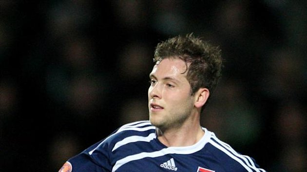Paul Lawson, pictured, and Gary Glen netted late for Ross County