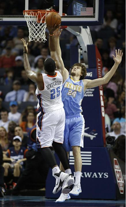 Charlotte Bobcats center Al Jefferson, left, shoots over Denver Nuggets forward Jan Vesely, of the Czech Republic, in the second half of an NBA basketball game in Charlotte, N.C., Monday, March 10, 20