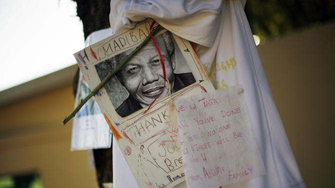 Get well soon messages and drawings are seen outside Nelson Mandela's house in Johannesburg, South Africa, Monday, July 1, 2013. Former president Nelson Mandela remains in a critical condition at the Medi-Clinic Heart Hospital in Pretoria on Monday . (AP Photo/Jerome Delay)