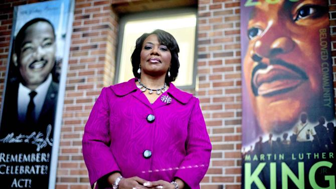 "In this Tuesday, Jan. 8, 2013 photo, Bernice King stands in the King Center next to banners hanging in memory of her father, Dr. Martin Luther King Jr., in Atlanta. One of her father's quotes has been cited as one of America's essential ideals, its language suggestive of a constitutional amendment on equality: ""I have a dream that my four little children will one day live in a nation where they will not be judged by the color of their skin but by the content of their character."" Yet today, 50 years after the Rev. Martin Luther King Jr.'s monumental statement, there is considerable disagreement over what this quote means when it comes to affirmative action and other measures aimed at helping the disadvantaged. (AP Photo/David Goldman)"
