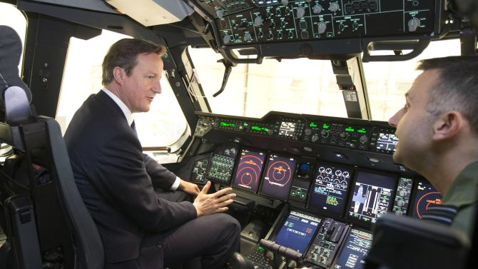 Britain's Prime Minister David Cameron views the flight deck of a newly delivered A400M Atlas aircraft with wing commander Simon Boyle at RAF Brize Norton, central England