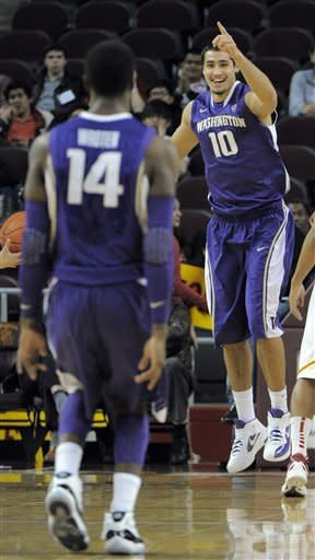 Washington beats USC 80-58 to earn share of Pac-12