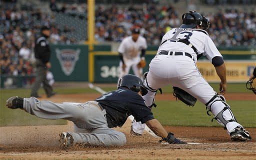 Mariners hold off Tigers 7-4