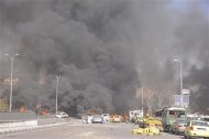 A view shows the site of an explosion at central Damascus February 21, 2013, in this handout photograph released by Syria&#39;s national news agency SANA. The big explosion shook the central Damascus district of Mazraa on Thursday, residents said, and Syrian state media blamed what it said was a suicide bombing on &quot;terrorists&quot; battling President Bashar al-Assad. Syrian television broadcast footage of at least four bodies strewn along a main street and firefighters dousing the charred remains of dozens of burning vehicles. Black smoke billowed into the sky. REUTERS/Sana
