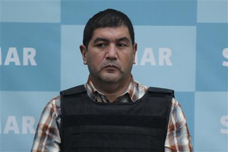 Ivan Velasquez Caballero, a suspected drug leader of the Zetas drug cartel, is presented to the media in Mexico City