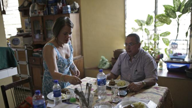 Mayor Mauricio Vilanova eats lunch with his wife Roxana after patrolling as part of the municipality security program in San Jose Guayabal