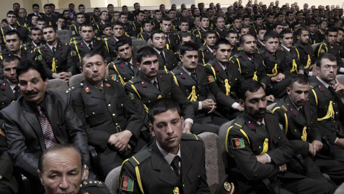 Afghan security officials attend a handover ceremony at a military academy on the outskirts of Kabul, Afghanistan, Tuesday, June 18, 2013. Afghan forces have taken over the lead from the U.S.-led NATO coalition for security nationwide, President Hamid Karzai announced Tuesday in a significant milestone in the 12-year war. (AP Photo/Rahmat Gul)