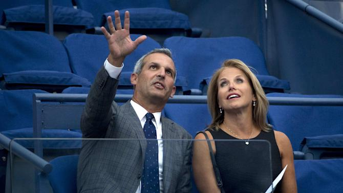 Television personality Couric and husband Molner attend the match between Williams of the U.S. and Diatchenko of Russia at the U.S. Open Championships tennis tournament in New York
