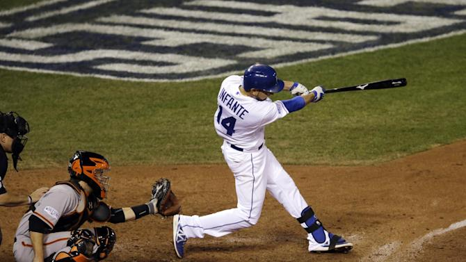 Kansas City Royals' Omar Infante hits a two-run home run during the sixth inning of Game 2 of baseball's World Series against the San Francisco Giants Wednesday, Oct. 22, 2014, in Kansas City, Mo. (AP Photo/Jeff Roberson)