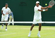 "India's Mahesh Bhupathi plays a shot at the net during his first round men's doubles match with India's Rohan Bopanna (L) at Wimbledon. Bhupathi on Wednesday slammed India's tennis chiefs for putting top female player Sania Mirza in an ""unbelievable position"" in the country's bitter Olympic selection row"