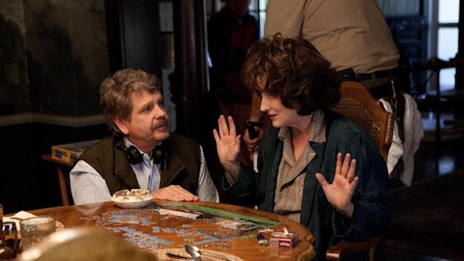 """This image released by The Weinstein Company shows director John Wells, left, and actress Meryl Streep during the filming of """"August: Osage County."""" Streep was nominated for a Golden Globe for best actress in a motion picture musical or comedy for her role in the film. (AP Photo/The Weinstein Company, Claire Folger)"""