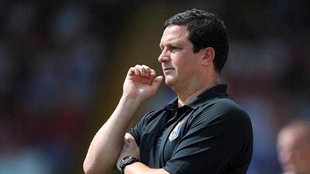 Mansfield boss Paul Cox, pictured, has paid an undisclosed fee for Ollie Palmer