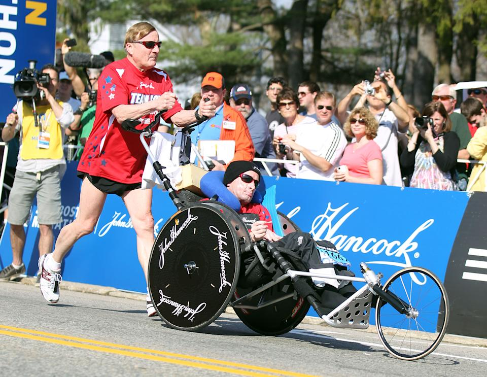 Dick Hoyt, left, and his son, Rick, start the 116th running of the Boston Marathon, in Hopkinton, Mass., Monday, April 16, 2012. (AP Photo/Stew Milne)
