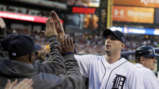 Detroit Tigers' Max Scherzer is congratulated by teammates after being taken out of the game in the sixth inning during Game 4 of the American League championship series against the New York Yankees Thursday, Oct. 18, 2012, in Detroit. (AP Photo/Matt Slocum)