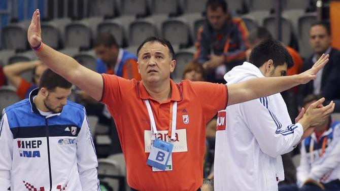 Coach Goluza of Croatia reacts during their quarterfinal match of the 24th Men's Handball World Championship against Poland in Doha