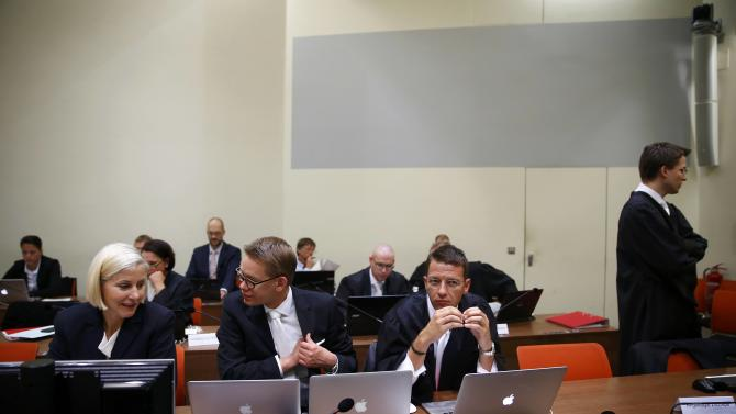 Lawyer Grasel stands next to lawyers Sturm, Heer and Stahl as they wait for defendant Beate Zschaepe before the continuation of her trial at a courtroom in Munich