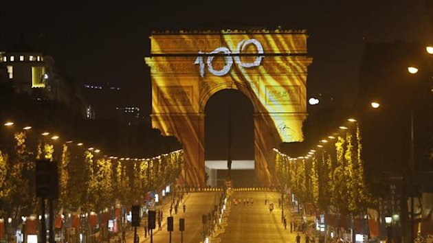 The Arc de Triomphe and the Champs Elysees Avenue are illuminated with the colour of Tour de France winner yellow jersey after the 133.5km final stage of the centenary Tour de France cycling race from Versailles to Paris Champs Elysees. (Reuters)