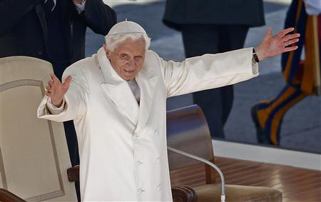 Pope Benedict XVI waves in Saint Peter's Square at the Vatican during his last general audience