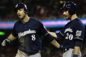 Surging Brewers rally with 3 in ninth, stun Nats