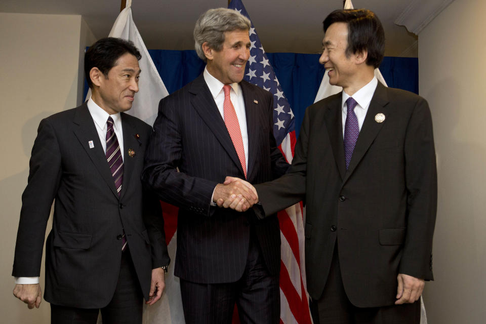 Japan's Foreign Minister Fumio Kishida, left, U.S. Secretary of State John Kerry, and South Korea's Foreign Minister Yun Byung-se, pose for a photograph before their group meeting at ASEAN in Bandar Seri Begawan, Brunei on Monday, July 1, 2013. (AP Photo/Jacquelyn Martin, Pool)