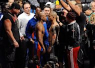 Floyd Mayweather (L) and WBA super welterweight champion Miguel Cotto face off during the official weigh-in for their bout at the MGM Grand Garden Arena, on May 4, in Las Vegas, Nevada. Cotto defends his title on May 5