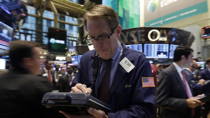 Trader Luke Scanlon works on the floor of the New York Stock Exchange Thursday, Oct. 10, 2013. World stock markets fell Wednesday, Oct. 23, 2013 hit by slower U.S. hiring and reports of tighter money market conditions in China that could check its economic recovery. (AP Photo/Richard Drew)