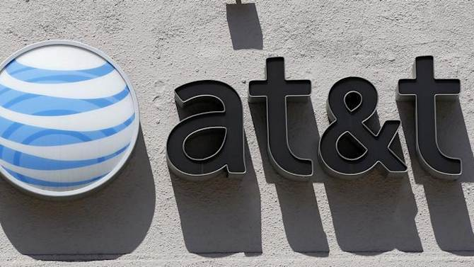 An At&T logo is seen atop a store in Beverly Hills, California