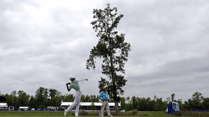 Guan Tianlang, 14, of China, tees off at the ninth hole during the second round of the PGA Zurich Classic golf tournament at TPC Louisiana in Avondale, La., Friday, April 26, 2013. (AP Photo/Gerald Herbert)