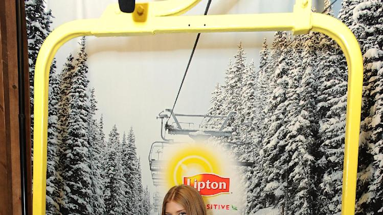 IMAGE DISTRIBUTED FOR LIPTON: At the Lipton Uplift Lounge, actress AnnaLynne McCord takes a break from her busy day promoting the first Cat Dance Film Festival during Sundance on Saturday Jan. 19, 2013, in Park City, UT. (Photo by Jordan Strauss/Invision for Lipton/AP Images)