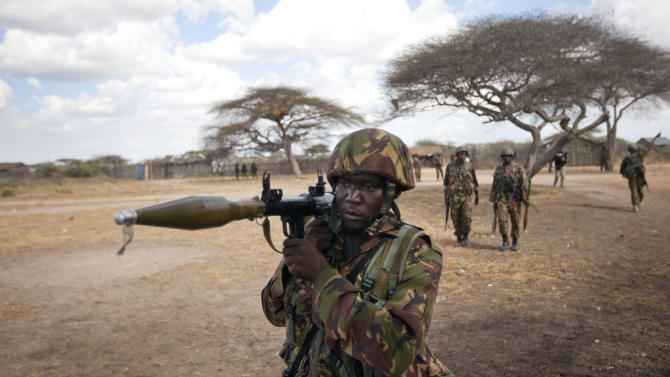 FILE - In this Monday, Feb. 20, 2012 file photo, a Kenyan army soldier carries a rocket-propelled grenade launcher as he patrols in Tabda, inside Somalia. Kenya's military said Friday, Sept. 28, 2012 that its troops attacked Kismayo, the last remaining port city held by al-Qaida-linked al-Shabab insurgents in Somalia, during an overnight attack involving a beach landing. (AP Photo/Ben Curtis, File)