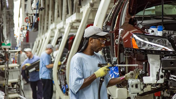 "FILE - In this June 12, 2013 file photo, workers assemble Volkswagen Passat sedans at the German automaker's plant in Chattanooga, Tenn. The United Auto Workers unions announced on Thursday, July 10, 2014, that it is forming a local chapter in Chattanooga, and that it expects Volkswagen to recognize it once it signs up a ""substantial"" number of workers at the plant.(AP Photo/ Erik Schelzig, file)"
