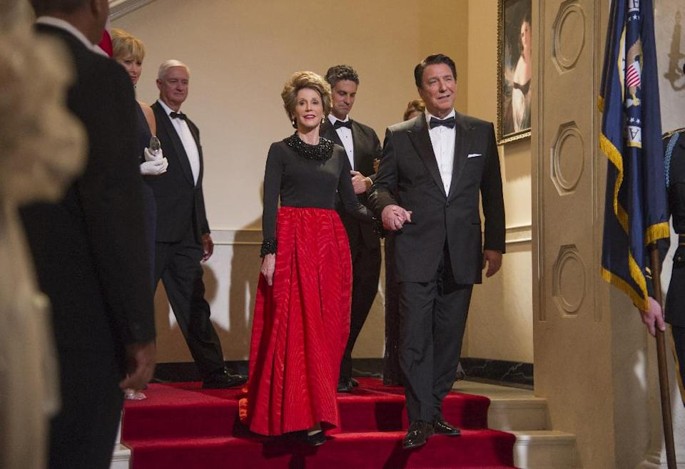 "This film image released by The Weinstein Company shows Jane Fonda as Nancy Reagan, center left, and Alan Rickman as Ronald Reagan in a scene from ""Lee Daniels' The Butler."" (AP Photo/The Weinstein Company, Anne Marie Fox)"