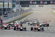 Red Bull-Renault driver Sebastian Vettel of Germany (right) leads the pack at the start of the Formula One Korean Grand Prix at the Korean Circuit in Yeongam on October 14. A peerless Vettel leapfrogged Fernando Alonso at the top of the world championship on Sunday as the Red Bull driver led from the first corner to win