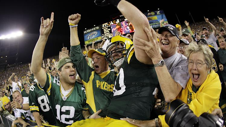 Green Bay Packers' John Kuhn celebrates a touchdown run during the second half of an NFL football game against the New Orleans Saints Thursday, Sept. 8, 2011, in Green Bay, Wis. The Packers won 42-34. (AP Photo/Morry Gash)
