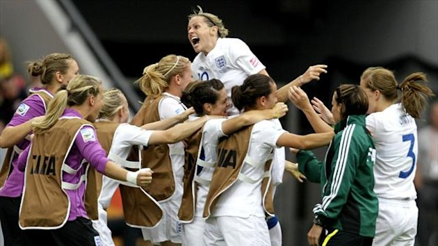 England's women's players celebrate a goal (Reuters)