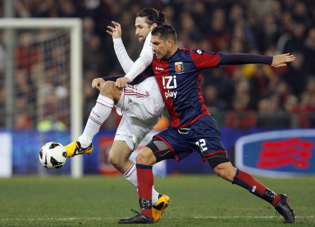 AC Milan's Yepes fights for the ball with Genoa's Borriello during their Italian Serie A soccer match in Genoa