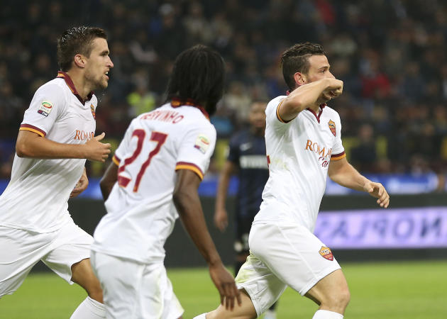 AS Roma midfielder Alessandro Florenzi, right, celebrates with his teammates Kevin Strootman, left, of the Netherlands, and Gervinho, of Ivory Cost, after scoring during the Serie A soccer match betwe