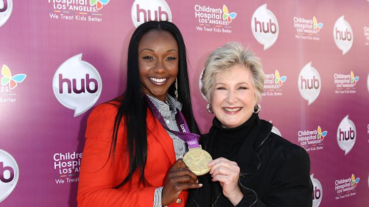 "IMAGE DISTRIBUTED FOR THE HUB - Carmelita Jeter, left, and Margaret Loesch, president and CEO of The Hub TV Network, attend The Hub TV Network's ""My Little Pony Friendship is Magic"" Coronation Concert at the Brentwood Theatre on Saturday, Feb. 9, 2013, in Los Angeles in support of Children's Hospital LA. (Photo by Matt Sayles/Invision for The Hub/AP Images)"