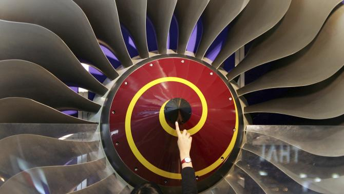 File picture shows a visitor touching a Rolls-Royce swept fan on display at the Aviation Expo China in Beijing